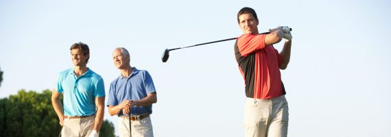 Group of executive golfers on golf course
