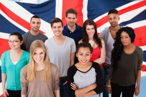 "<img src=""Group of English students in front of a British flag.jpg"" alt=""group of students in front of the British flag"">"