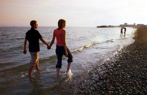LSI Portsmouth students walk down beach