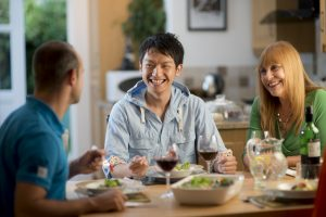Executive student laughing with family