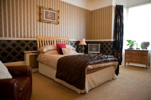 A double bed in a comfortable executive room.