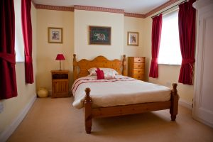 Spacious double bedroom in executive accommodation.