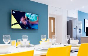 LSI Portsmouth Student house dining room ready for dinner and large TV