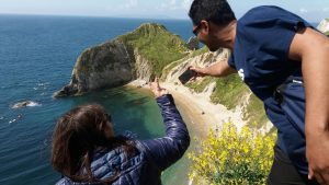 Students having fun taking pictures on the Jurassic coast.