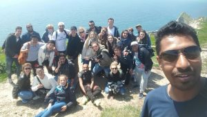 Group of LSI Portsmouth students on cliffs at Jurassic coast.