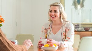 LSI Portsmouth student drinks tea with host mother.