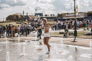 Woman dancing in the fountains of Southsea Castle