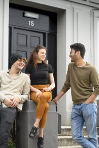 Students hanging out in the street by LSI Portsmouth student accommodation.