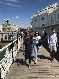 Students walking on Brighton pier