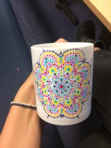 LSI Student admires her mug