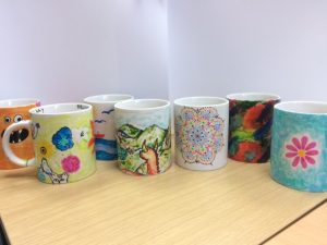 Collection of LSI Portsmouth student mugs