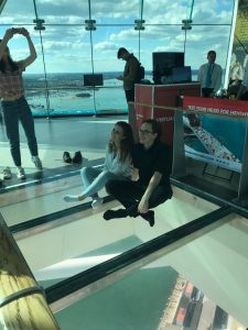 LSI Portsmouth students sitting on glass floor in Spinnaker tower