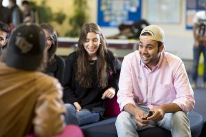 LSI Portsmouth students hanging out and chatting in student lounge