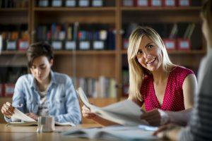 Study centre teacher helps student