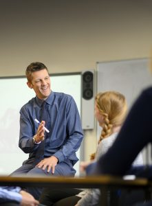 General English teacher laughing with students