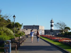 People walking to the Portsmouth lighthouse