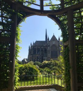 A view of the church at Arundel taken through a garden.
