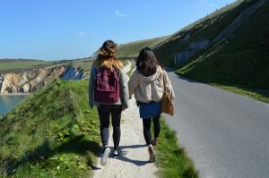 2 LSI Porstmouth friends walk along the road