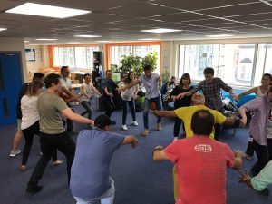 LSI Portsmouth students dance salsa in student lounge
