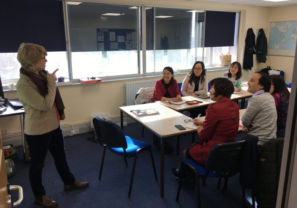 students from Vietnam work hard on English language course